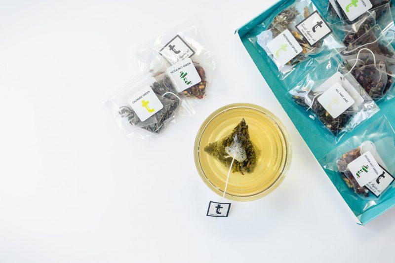 Green Teas Tasting Menu Teabag brewing in cup